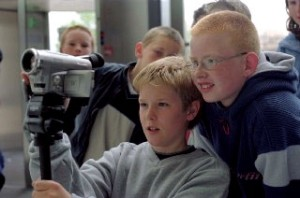 Children filming an advert